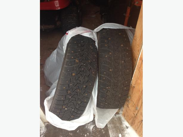 **REDUCED** TWO STUDDED TIRES