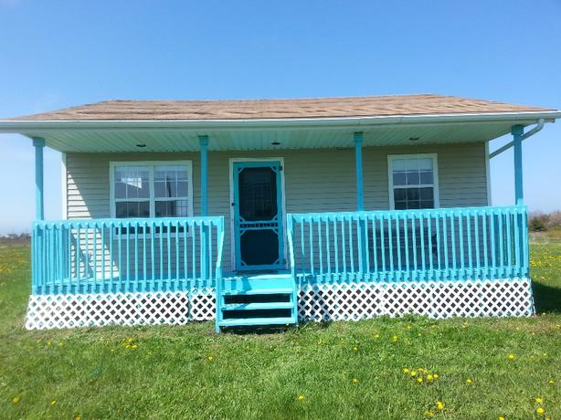 REDUCED!! Beautiful Cottage for sale....5 minute walk to Beach!
