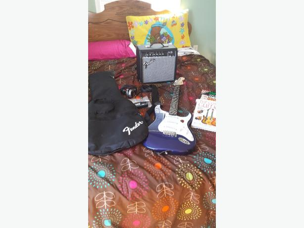 Fender guitar with amp. well sell or trade for a youth four weeler