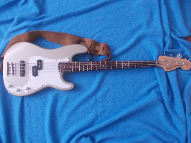 Squier bass with case and Fender amp