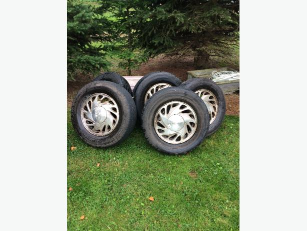 4 tires on aluminum rims and 3 tires with no rims