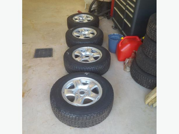 Firestone Winterforce tires and Rims for a Toytoa Rav 4  215/70/R16