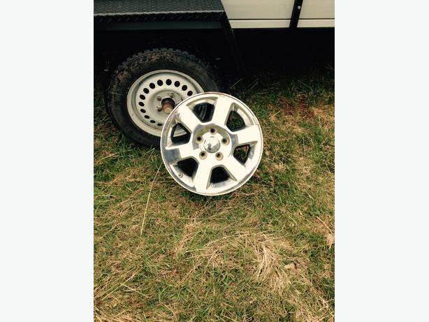 4 Jeep 17 inch rims in excellent shape