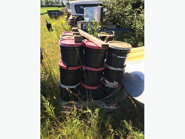Buckets of roofing tar